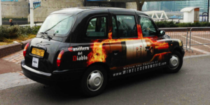 mega side taxi advertisement in the uk