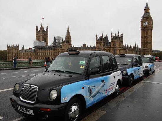 black cab outside big ben in london